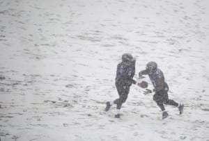 Joe Flacco et Ray Rice dans la neige!