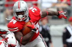 Ohio State University running back Hyde runs by Miami University defensive lineman Semmes during their NCAA football game in Columbus