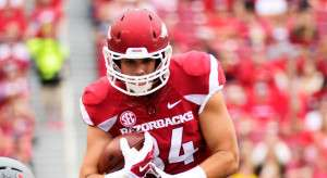 Arkansas tight end Hunter Henry carries in the first half of an NCAA college football game in Fayetteville, Ark., Friday, Sept. 6, 2014. (AP Photo/Sarah Bentham)